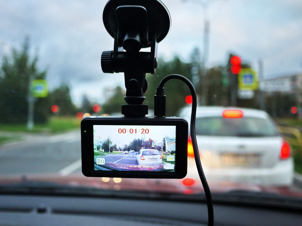 A lorry dash cam is recording while driving on the road
