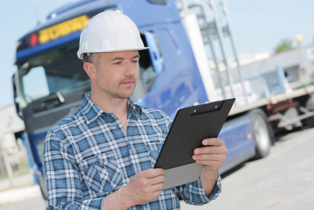Lorry driving is checking the transport routes