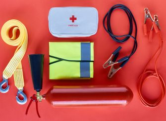 Vehicle essentials kit - first aid box, jump start cable etc